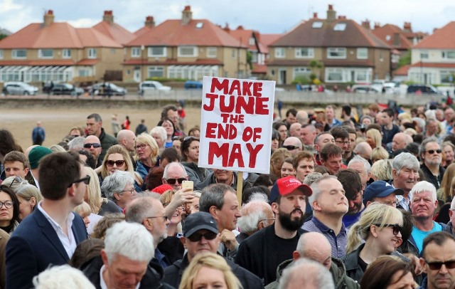 Supporters gather before a campaign visit by Labour Leader Jeremy Corbyn in West Kirby on May 20, 2017